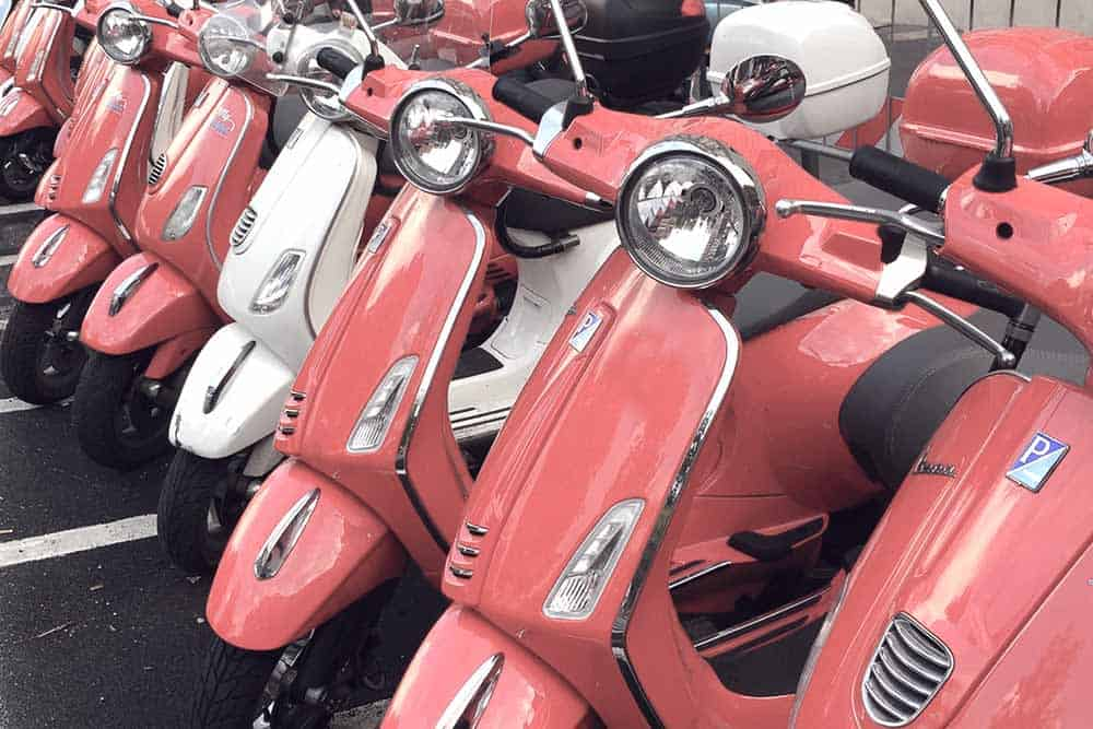 Take a vespa ride around Rome