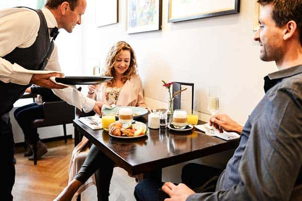 Grab your meals at Ambassade Hotel's restaurant