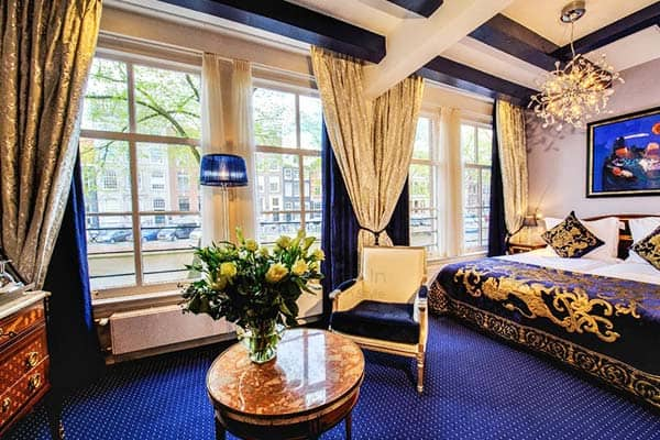 Ambassade Hotel features luxurious room decors with Louis XV furnishing