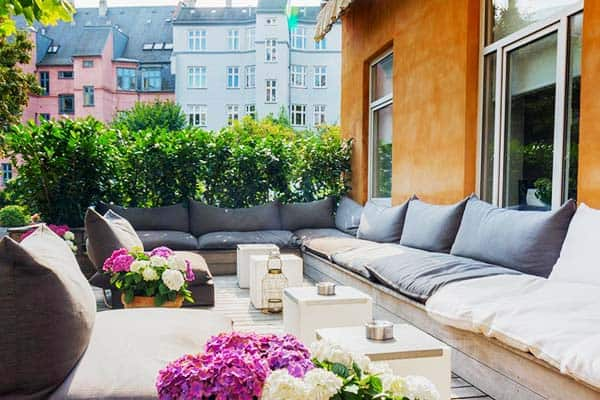 Enjoy the outdoor ambiance of the balcony at Avenue Hotel