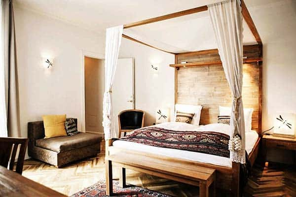 Rooms in Axel Guldsmeden Hotel are designed with Balinese-style furnishings and Persian rugs