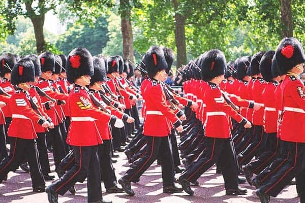 Visit the Buckingham Palace and see the palace guard parade