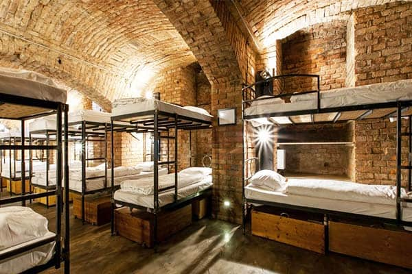 Rooms at the Czech Inn Hostel are designed with brick walls that make you feel the vibe of Prague