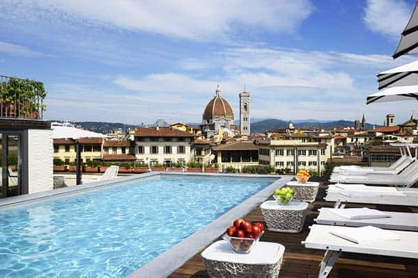 Enjoy the rooftop pool at Grand Hotel Minerva