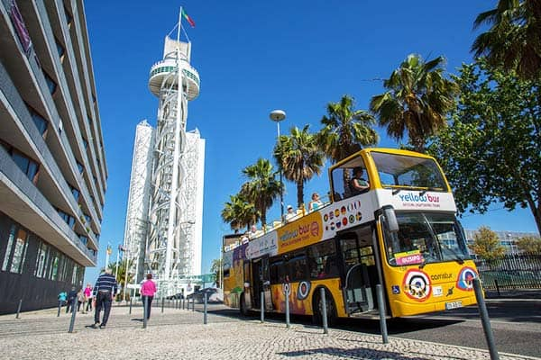 Hop-on and Hop-off over 63 bus stops in 4 routes to see Lisbon