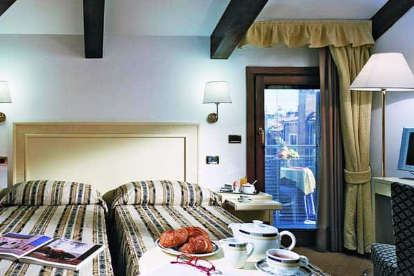 Rooms offer a balcony with a view of the canal at Hotel Giudecca Venezia