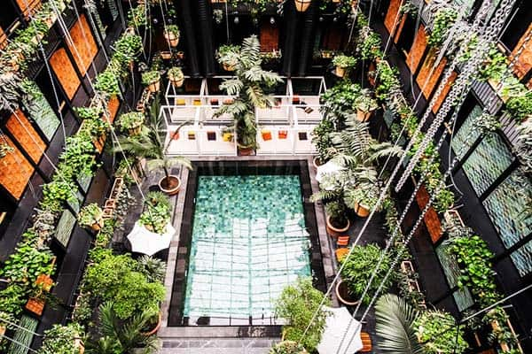 Take a dip at the pool and meet people at Manon Les Suites Guldsmeden