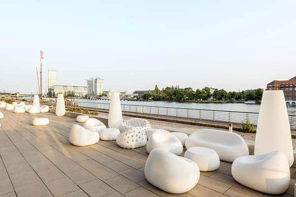 Relax and chill at Nhow Hotel's balcony over the River Spree
