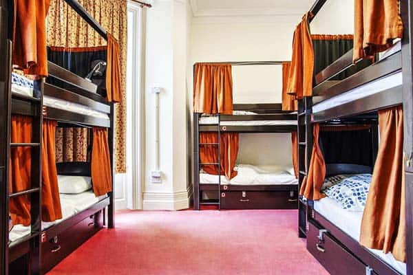 Each bed are equipped with your own curtain for privacy at Palmers Lodge Swiss Cottage