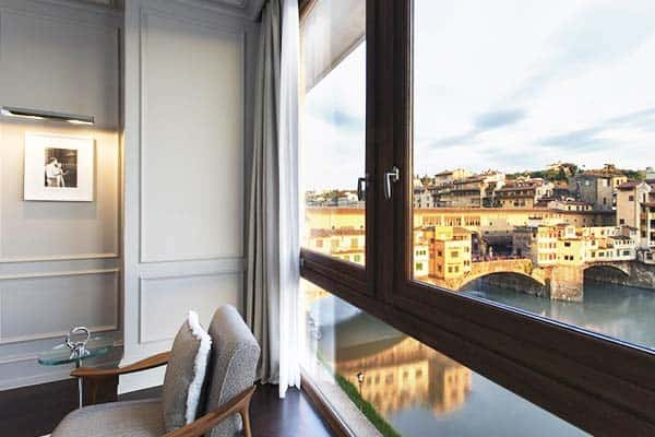Get a perfect view of Ponte Vecchio bridge at Portrait Firenze Lungarno Collection