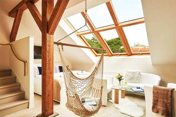 Rooms offer natural lighting and have hammocks for relaxation