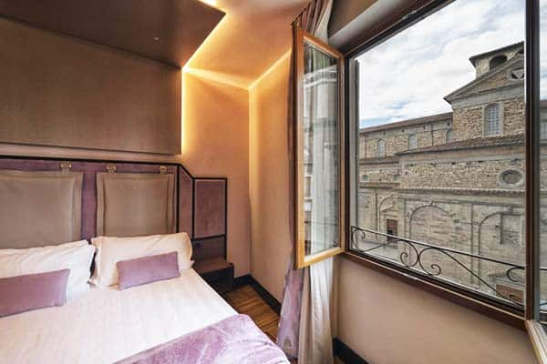 Enjoy the stunning view of San Lorenzo Basilica from Solo Experience Hotel