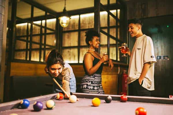 Enjoy a game of pool with other guests at The Generator Hostel