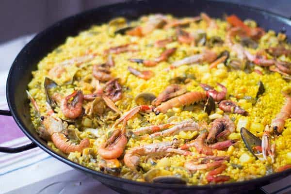 Where do locals eat paella in Barcelona