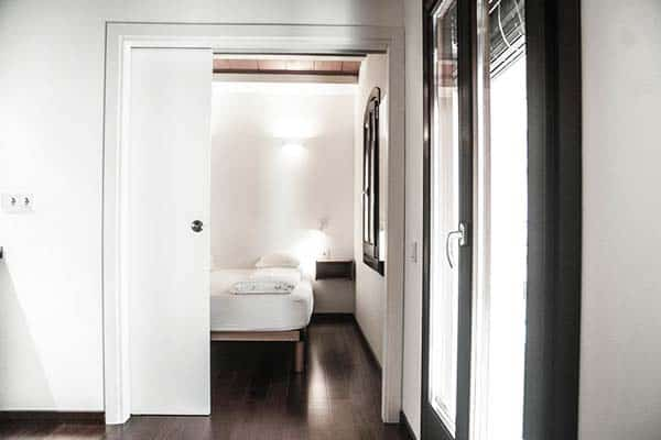 Achieve a good night's sleep in your bed after a long beach day at Barcelona Beach Apartments
