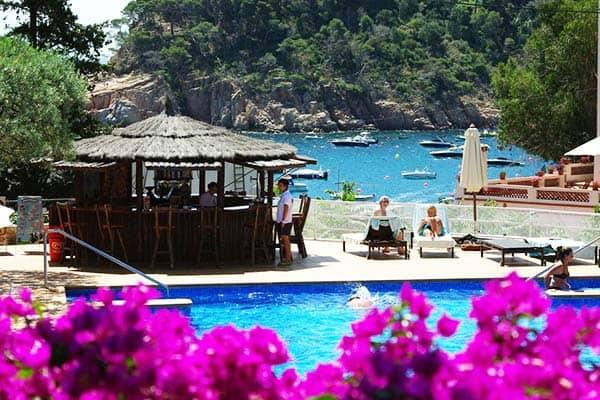Appreciate the sun and take a dip at Hotel Aiguablava's pool