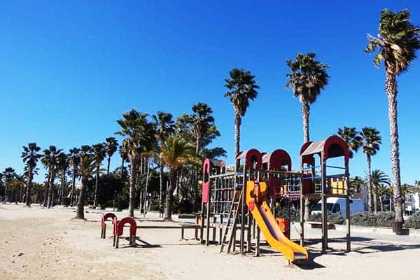 Have you children play at the kid's playground at Llevant Beach