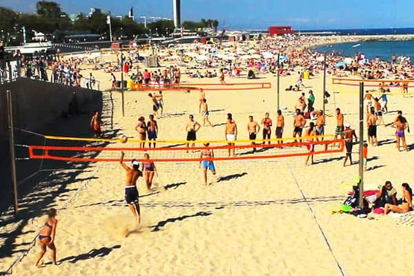 Join in a friendly beach volleyball game at Mar Bella Beach