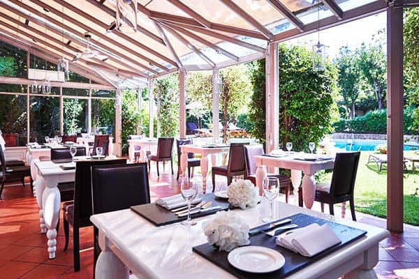 Enjoy the sun and the Italian cuisine at Sina Villa Medici Restaurant by the pool