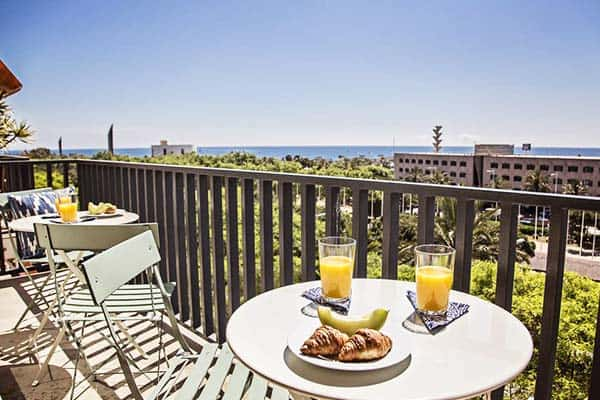 Enjoy a wonderful breakfast at the balcony in Sweet Inn Villa Olympica