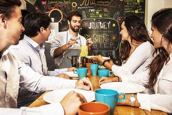 Share a meal with new friends at Twentytu Hostel