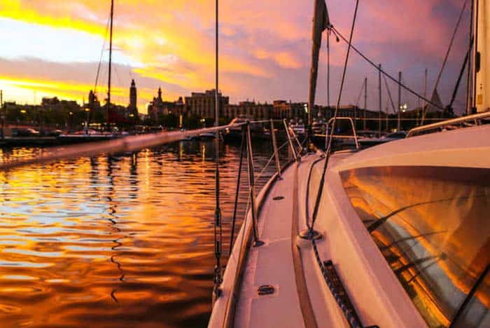 Watch the sun set and party with new friends at a boat party
