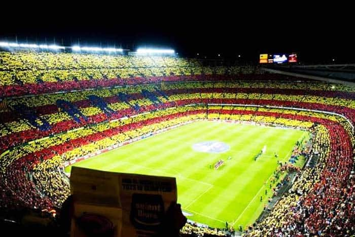 Visit Camp Nou and see a football match