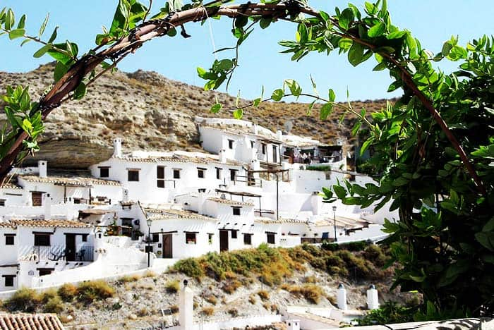 See the white houses in the mountain in Galera, Spain