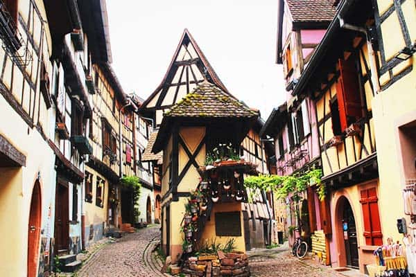 Walk along narrowed streets and admire old buildings in Strasbourg